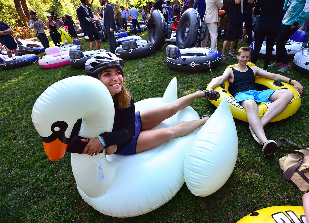 . Meg Viola, poses for photos with her raft as she and Gunther Fox wait for the start of the 11th Annual Tube to Work Day, in Eben G. Fine Park in Boulder on Wednesday morning.  Paul Aiken Staff Photographer July 11 2018