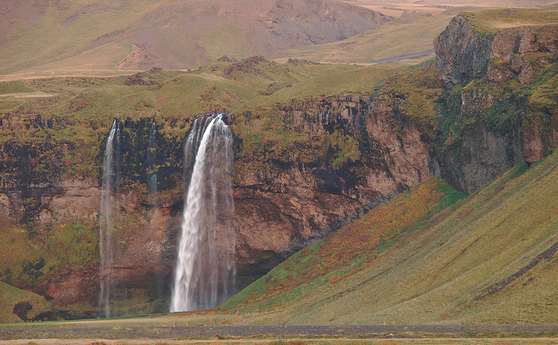 Seljalandsfoss waterfall from Highway 1 in south Iceland. Remember the Eyjafjallajökull volcanic eruption from April 2010 which crippled most of Europe. It is right above that waterfall (to the right) as you look. Unfortunately for me is was still asleep!