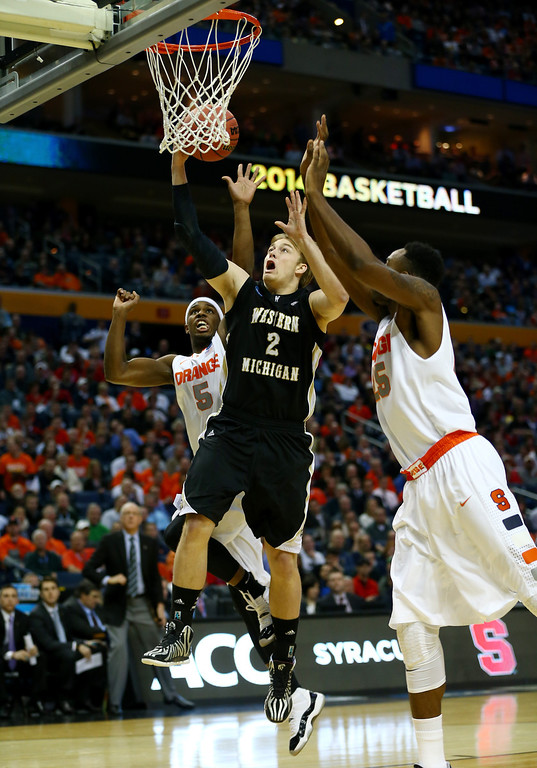 . BUFFALO, NY - MARCH 20: Connar Tava #2 of the Western Michigan Broncos goes to the basket against the Syracuse Orange C.J. Fair #5 of the Syracuse Orange defends during the second round of the 2014 NCAA Men\'s Basketball Tournament at the First Niagara Center on March 20, 2014 in Buffalo, New York.  (Photo by Elsa/Getty Images)