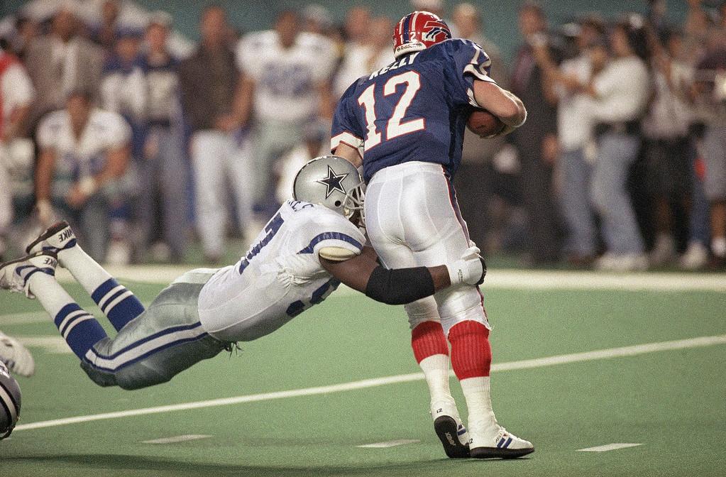 . BUFFALO BILLS - Buffalo Bills quarterback Jim Kelly is sacked by Dallas Defenseman Jimmie Jones during the fourth quarter of the Super Bowl XXVIII, on Sunday, Jan 30, 1994 in Atlanta\'s Georgia Dome.  (AP Photo/John Gaps)