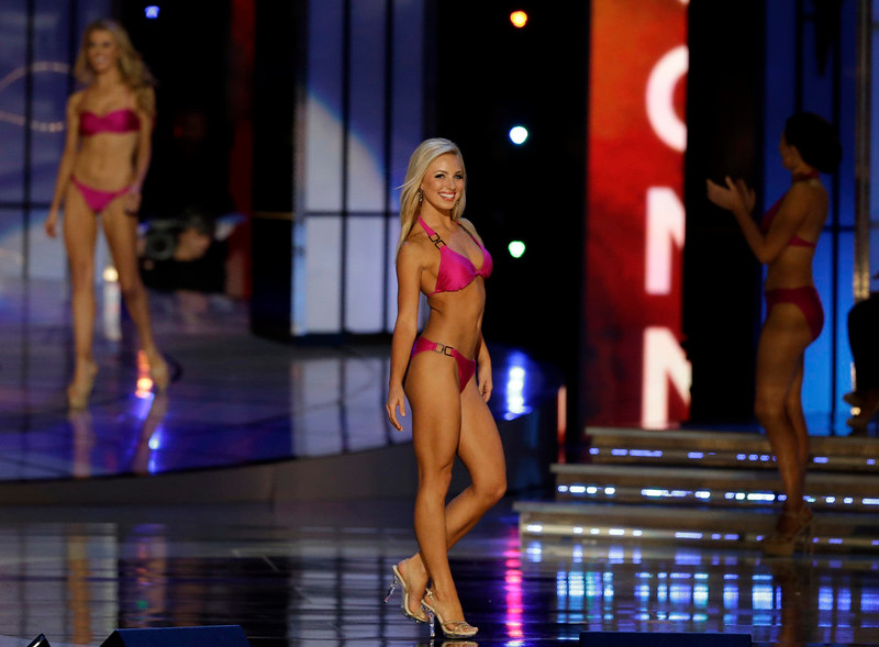 . Miss Florida Victoria Cowen displays her swimsuit during the Miss America 2015 pageant, Sunday, Sept. 14, 2014, in Atlantic City, N.J. (AP Photo/Mel Evans)
