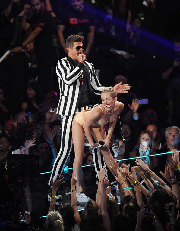 . Robin Thicke, left, and Miley Cyrus perform at the MTV Video Music Awards on Sunday, Aug. 25, 2013, at the Barclays Center in the Brooklyn borough of New York. (Photo by Scott Gries/Invision/AP)
