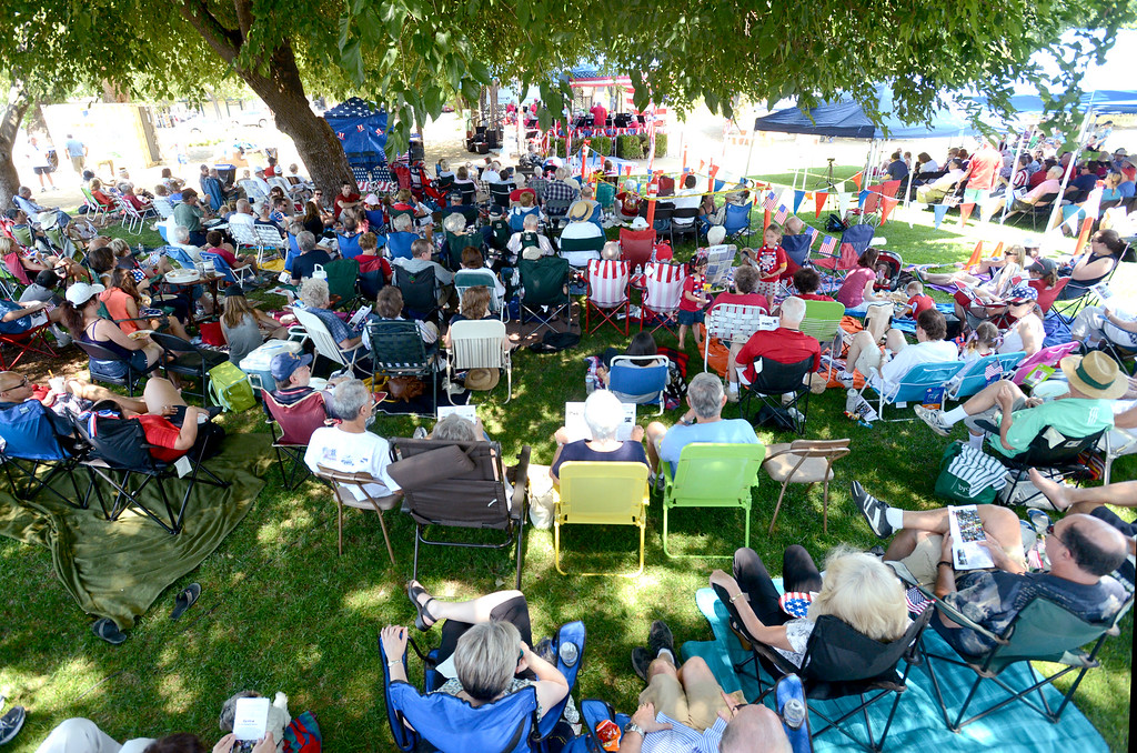 . People listen to the Pleasanton Community Concert Band during the 15th annual Fourth of July Picnic held at Lions Wayside Park in Pleasanton, Calif., on Thursday, July 4, 2013. The Independence Day celebration is sponsored by the Lions Club, Heritage Bank of Commerce, Raley\'s, and Accusplit stopwatches and pedometers. (Doug Duran/Bay Area News Group)