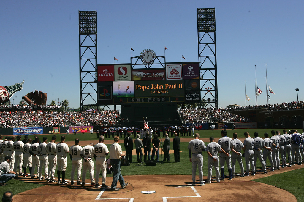 . The San Francisco Giants and the Los Angeles Dodgers stand in tribute to Pope John Paul II in pregame ceremonies on April 5, 2005 at SBC Park in San Francisco, California.  (Photo by Stephen Dunn/Getty Images)