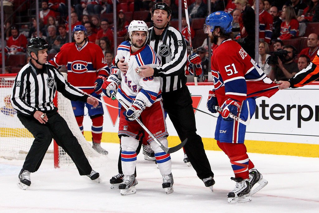 . MONTREAL, QC - MAY 17:  Mats Zuccarello #36 of the New York Rangers and David Desharnais #51 of the Montreal Canadiens exchange words in Game One of the Eastern Conference Finals of the 2014 NHL Stanley Cup Playoffs at the Bell Centre on May 17, 2014 in Montreal, Canada.  (Photo by Francois Laplante/FreestylePhoto/Getty Images)