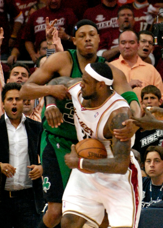 . Celtics forward Paul Pierce wraps up Cavaliers forward LeBron James during the second quarter of the Eastern Conference Semifinals Game 4 Tuesday.