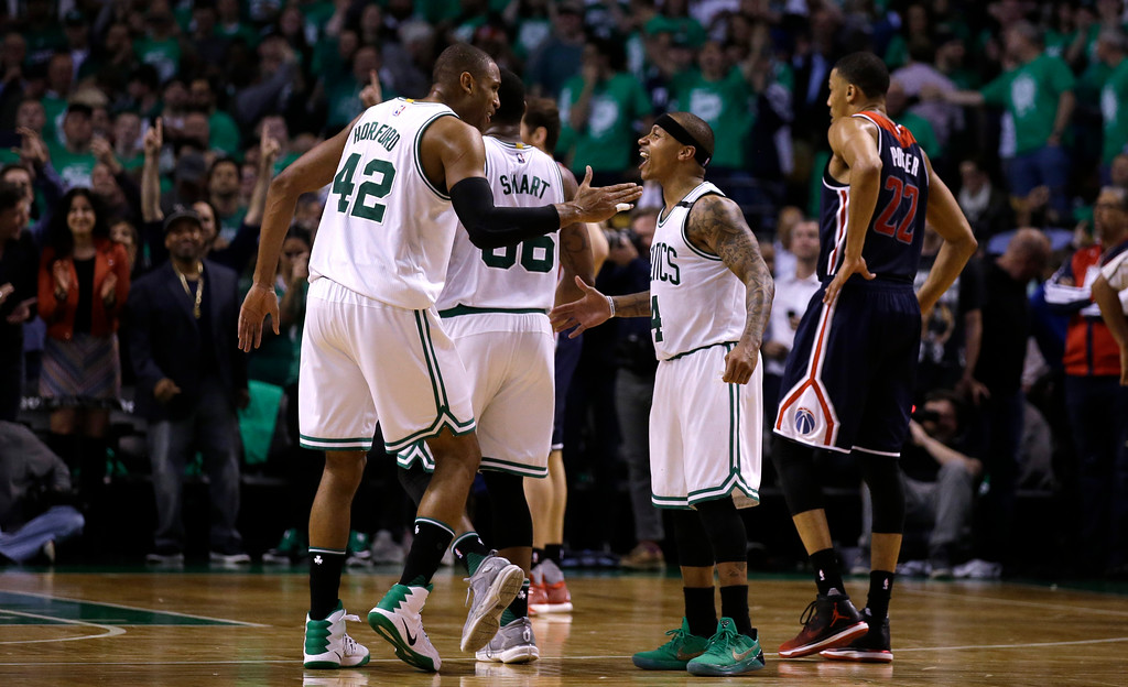 . Boston Celtics guard Isaiah Thomas (4) celebrates with Al Horford during the second half of Game 7 of an NBA basketball second-round playoff series Boston, Monday, May 15, 2017. (AP Photo/Charles Krupa)