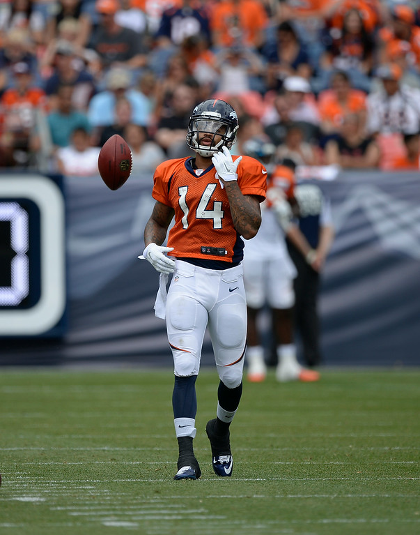. Denver Broncos wide receiver Cody Latimer (14) flips the football after catching a pass during drills on day four of the Denver Broncos 2014 training camp July 27, 2014 at Sports Authority Field at Mile High. (Photo by John Leyba/The Denver Post)