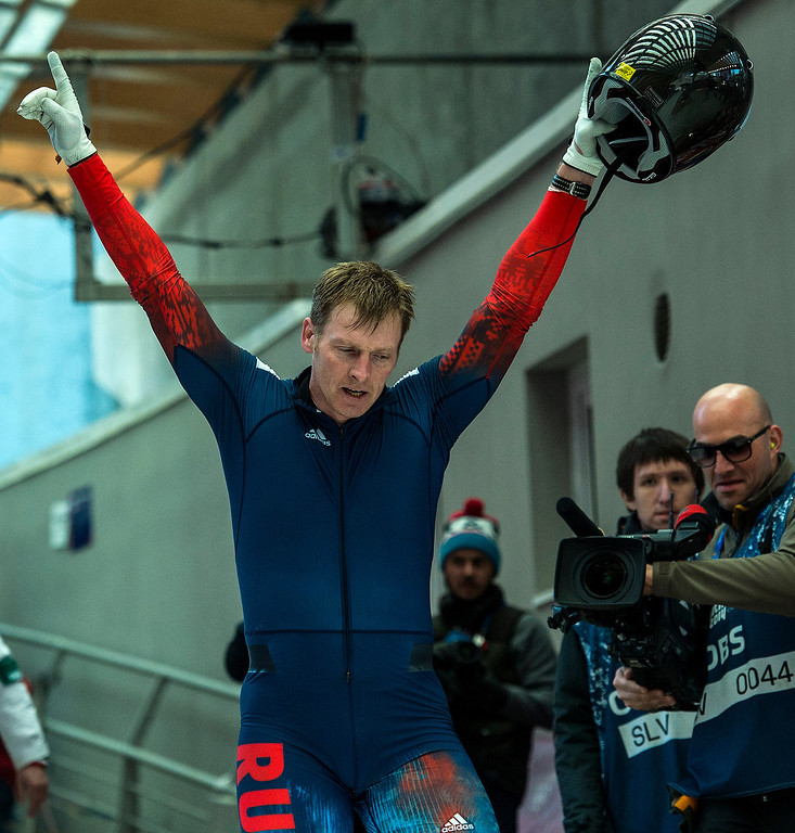 . Russian\'s Alexander Zubkov celebrates after winning during the four-man bobsled competition at Sanki Sliding Center during the 2014 Sochi Olympics Sunday February 23, 2014. Team Russia won the gold medal with a cumulative time of 3:40.60.