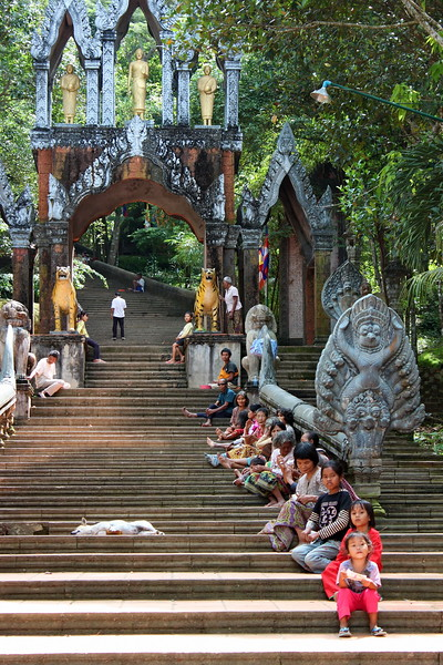 Stairs to the main temple atop Phnom Kulen with beggars lining the way