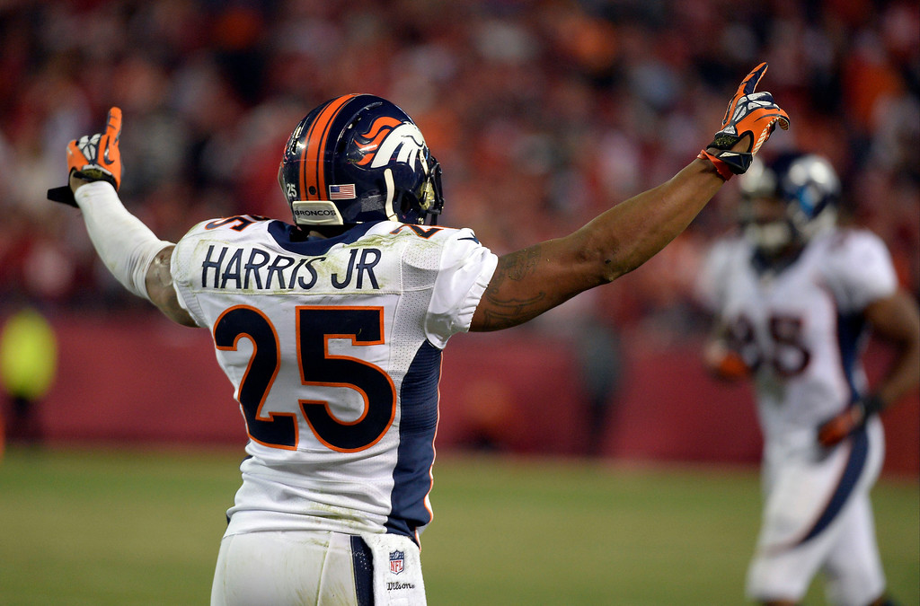 . Denver Broncos cornerback Chris Harris (25) celebrates a victory over the Kansas City Chiefs 35-28 December 1, 2013 at Arrowhead Stadium.  (Photo by John Leyba/The Denver Post)