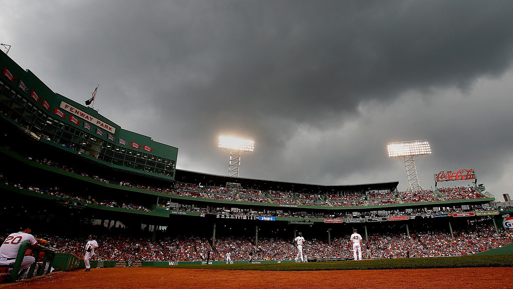 . David Ortiz #34 of the Boston Red Sox receives an intentional walk as the clouds and rain roll over the field during a game against the Colorado Rockies in the 7th inning at Fenway Park on June 26, 2013 in Boston, Massachusetts.  (Photo by Jim Rogash/Getty Images)