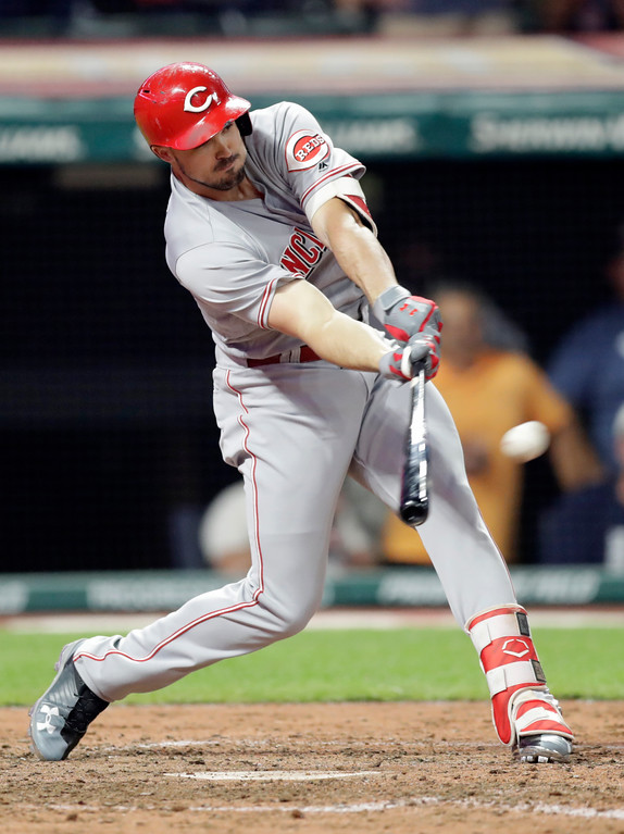. Cincinnati Reds\' Adam Duvall hits a two-run double off Cleveland Indians relief pitcher Cody Allen in the ninth inning of a baseball game, Tuesday, July 10, 2018, in Cleveland. Eugenio Suarez and Jose Peraza scored on the play. The Reds won 7-4. (AP Photo/Tony Dejak)