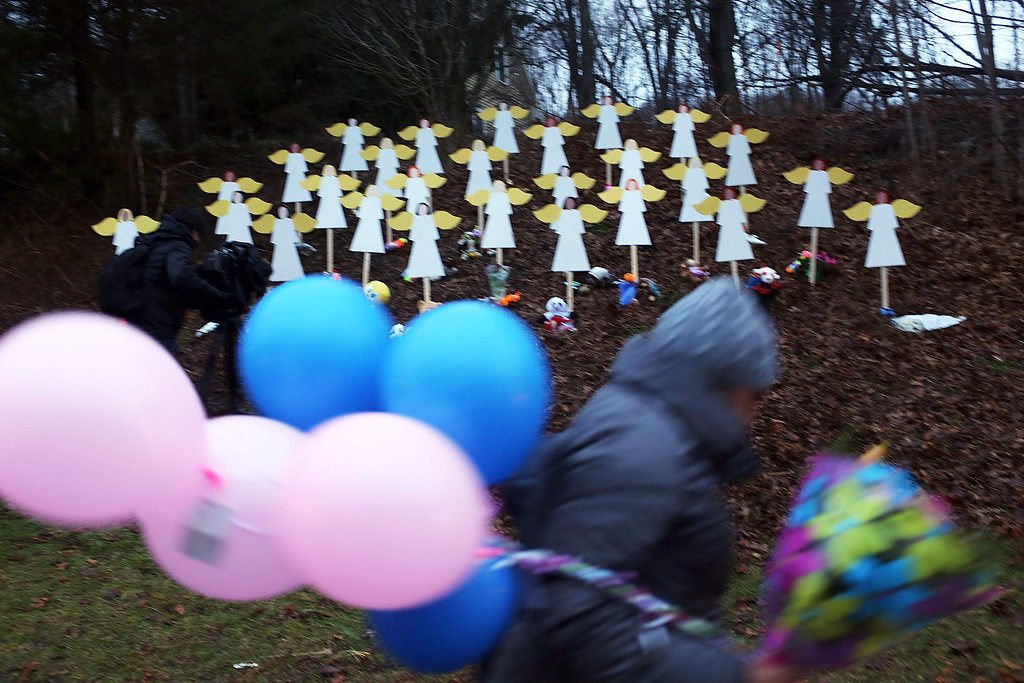 . NEWTOWN, CT - DECEMBER 16: Twenty seven wooden angles stand in a yard down the street from the Sandy Hook School December 16, 2012 in Newtown, Connecticut. Twenty-six people were shot dead, including twenty children, after a gunman identified as Adam Lanza opened fire at Sandy Hook Elementary School. Lanza also reportedly had committed suicide at the scene. A 28th person, believed to be Nancy Lanza, found dead in a house in town, was also believed to have been shot by Adam Lanza.  (Photo by Spencer Platt/Getty Images)