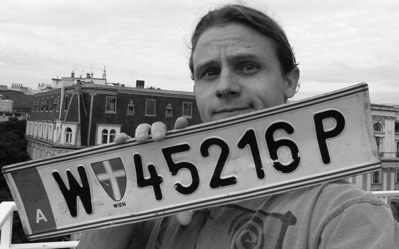 Self-portrait with the license plate from our car.  Unfortunately, we were unable to keep the tag.