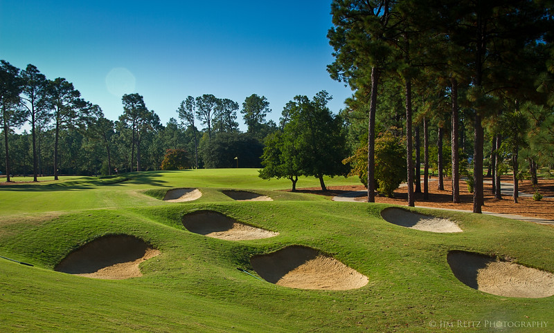 PINEHURST #4, first hole. Clusters of pot bunkers are a recurring theme on this Tom Fazio course.