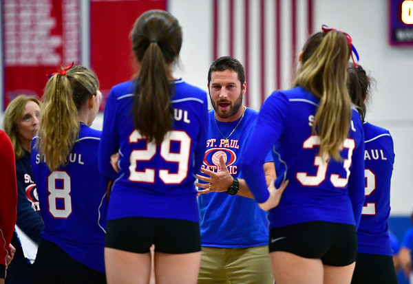 10/4/2019 Mike Orazzi | StaffrSt. Paul volleyball coach Devin Pecevich during Friday night's volleyball match with Crosby in Bristol. r