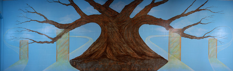 """6.   """"Wisdom Tree"""" mural. Panorama of entire mural wall including doors of decisions and pathways taken. 33 x 9.5 ft, acrylic on concrete block. 2010"""