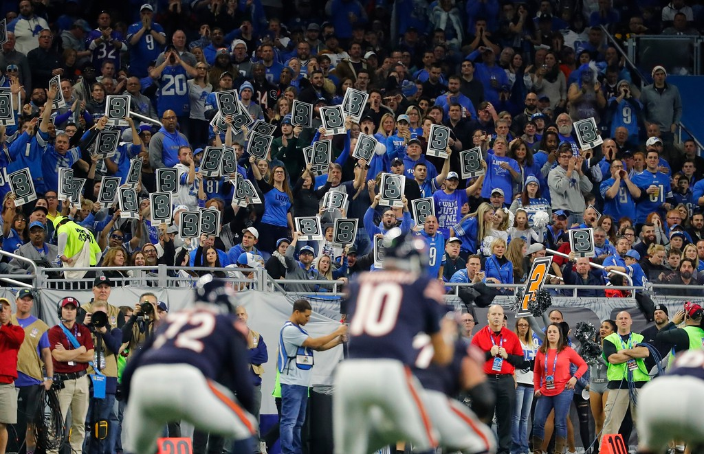 . Detroit Lions fans hold up third down placards as Chicago Bears quarterback Mitchell Trubisky (10) waits on the snap during the second half of an NFL football game, Saturday, Dec. 16, 2017, in Detroit. (AP Photo/Rick Osentoski)