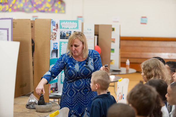 03/27/18 Wesley Bunnell | Staff First grade teacher Mrs. Poff demonstrates the magnetic slime to her students including an up close look by Austin Greener during the Smalley Academy 2nd Annual Smalley Science Fair on Tuesday morning featuring science exhibits by all grades.