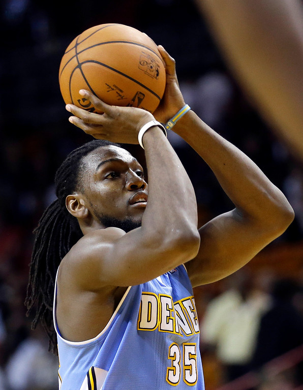 . Denver Nuggets forward Kenneth Faried (35) prepares to take a free throw against the Miami Heat during the second half of an NBA basketball game in Miami, Friday, March 14, 2014. The Nuggets won 111-107. (AP Photo/Alan Diaz)