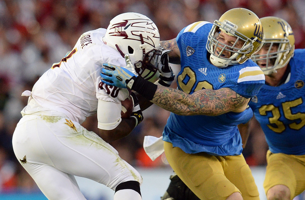 . UCLA�s Cassius Marsh #99 drags down Arizona State�s Marion Grice #1 during their game at the Rose Bowl Saturday November 23, 2013. Arizona State beat UCLA 38-33. (Photos by Hans Gutknecht/Los Angeles Daily News)