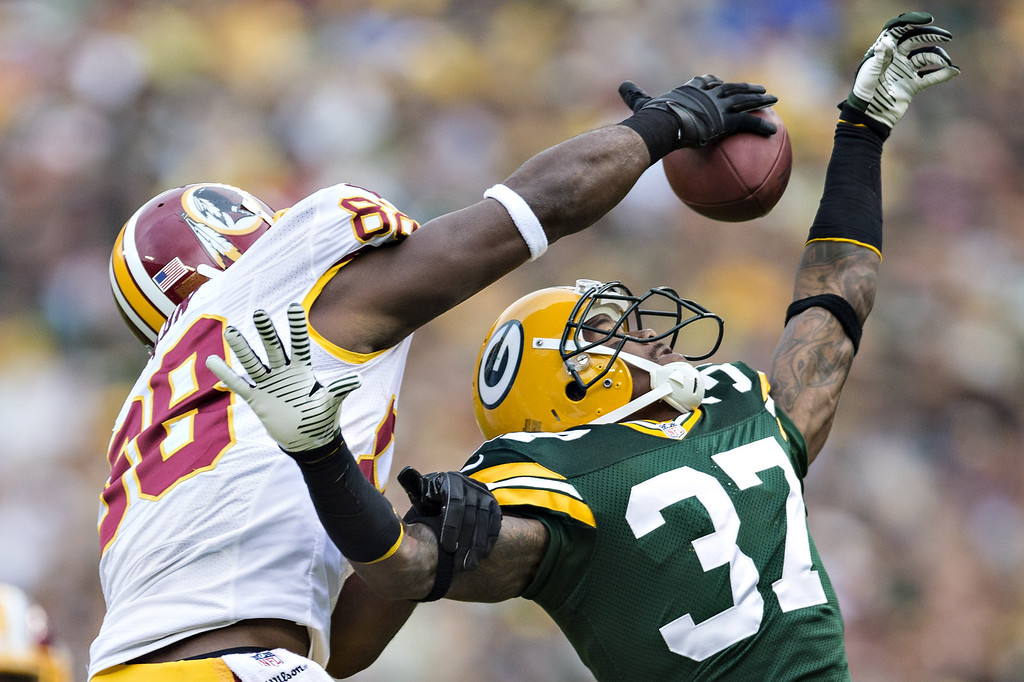 . Sam Shields #37 of the Green Bay Packers goes up for a interception but has the ball knocked away by Pierre Garcon #88 of the Washington Redskins at Lambeau Field on September 15, 2013 in Green Bay, Wisconsin. (Photo by Wesley Hitt/Getty Images)