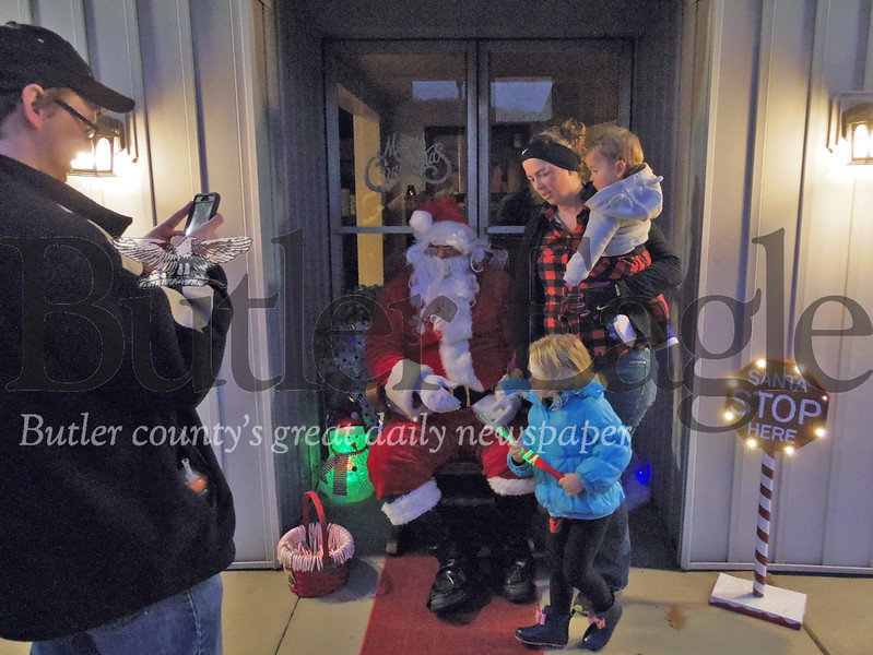 A family prepares to take a photo with Santa Claus during Chicora's Light Up Night on Sunday. Photo by Eric Jankiewicz