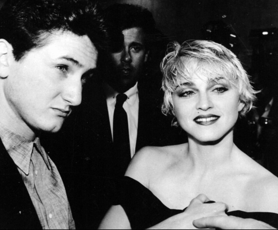 """. Sean Penn and his wife, singer Madonna, stop April 17, 1986 to chat with reporters prior to the screening of Penn\'s new movie \""""At Close Range\"""" in Los Angeles. (AP photo/Craig Mathew)"""