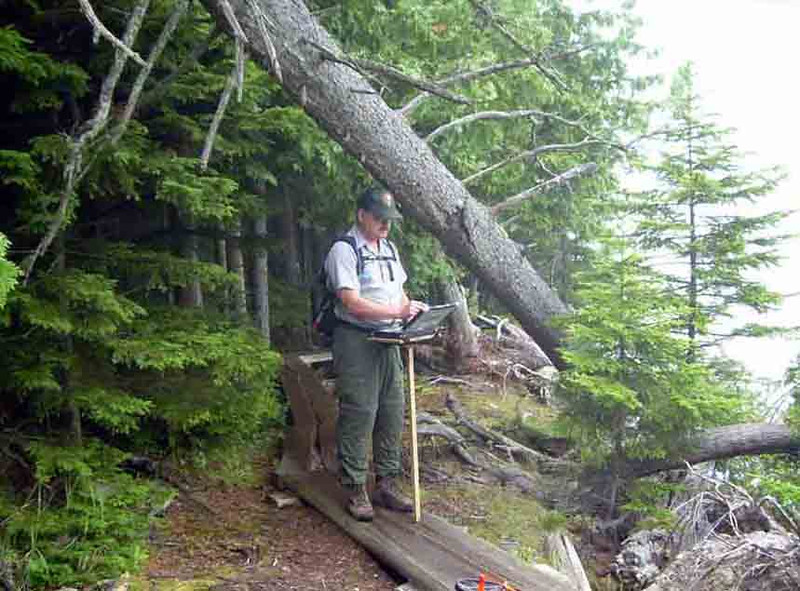 CAC-MAN Here I am working up a work order this fallen-down tree on Jordan Pond. There was no need to actually stand under said tree, but I thought it would lend a bit of humor to the process.