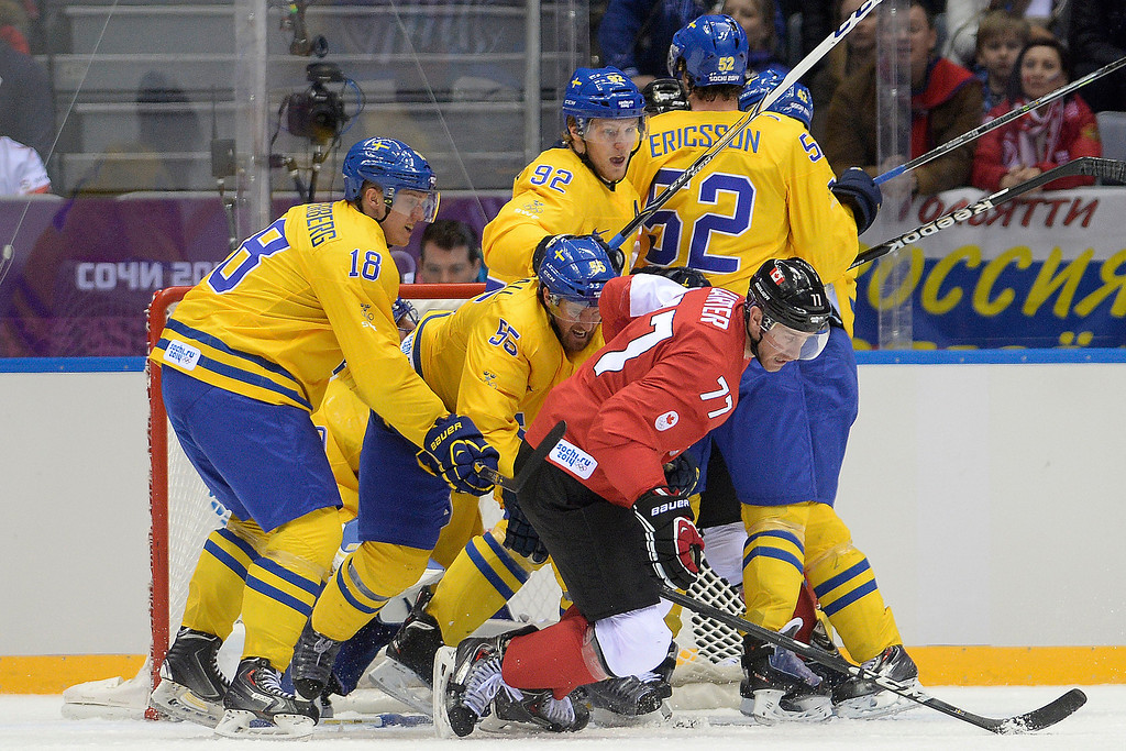 . Team Sweden gets physical with Jeff Carter (77) of Canada during the second period of the men\'s ice hockey gold medal game. Sochi 2014 Winter Olympics on Sunday, February 23, 2014 at Bolshoy Ice Arena. (Photo by AAron Ontiveroz/ The Denver Post)