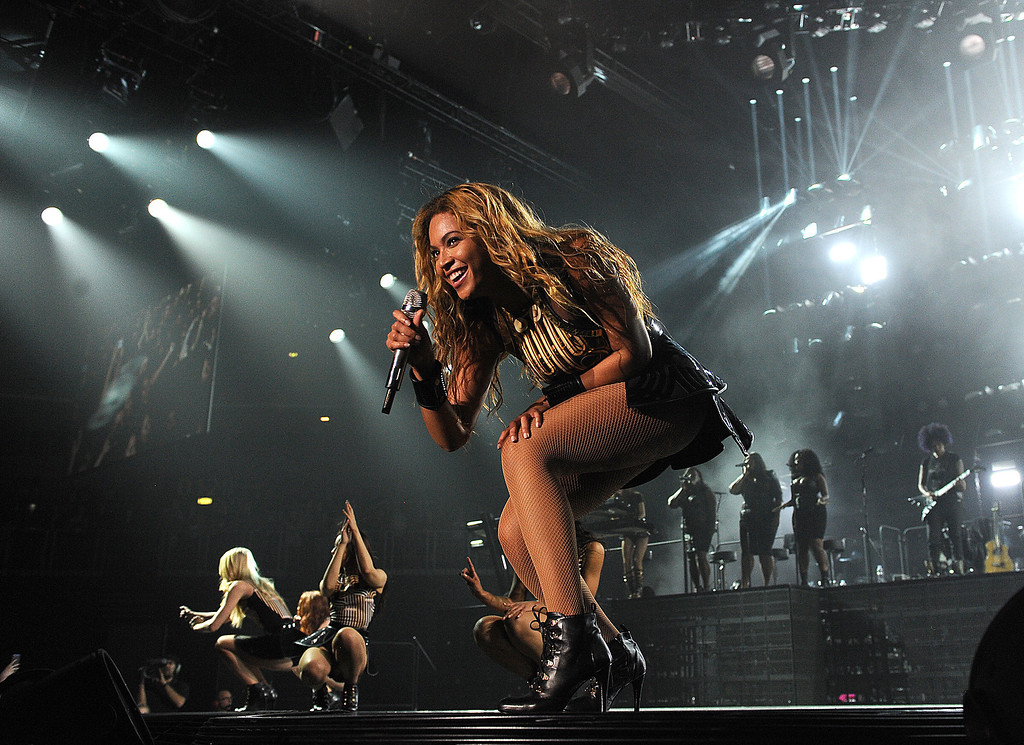 ". Singer Beyonce performs on her ""Mrs. Carter Show World Tour 2013\"", on Wednesday, April 17, 2013 at the Arena Zagreb in Zagreb, Croatia. Beyonce is wearing a gold and black one-piece with skirt by designer David Koma. (Photo by Frank Micelotta/Invision for Parkwood Entertainment/AP Images."