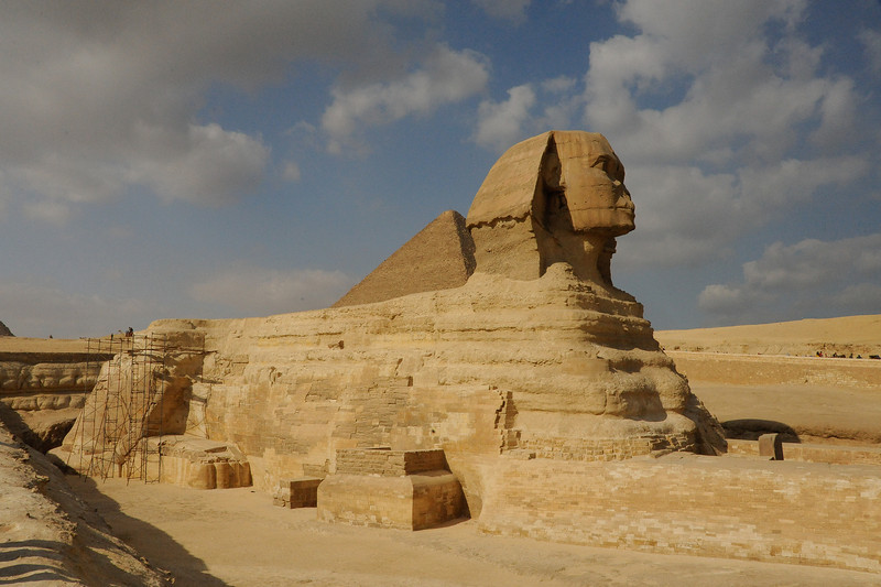 The Great Sphinx (the Great Pyramid of Khufu in the background).