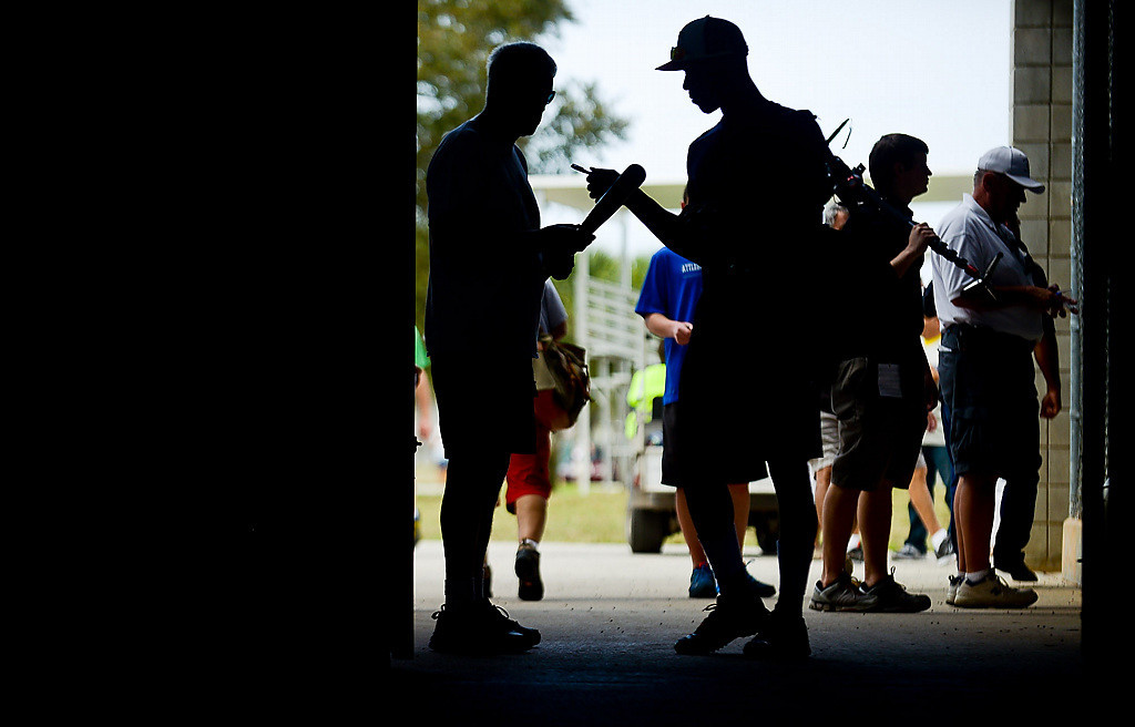 . Twins rookie Byron Buxton stops to sign an autograph before returning to the clubhouse after the end of the day\'s workout. (Pioneer Press: Ben Garvin)