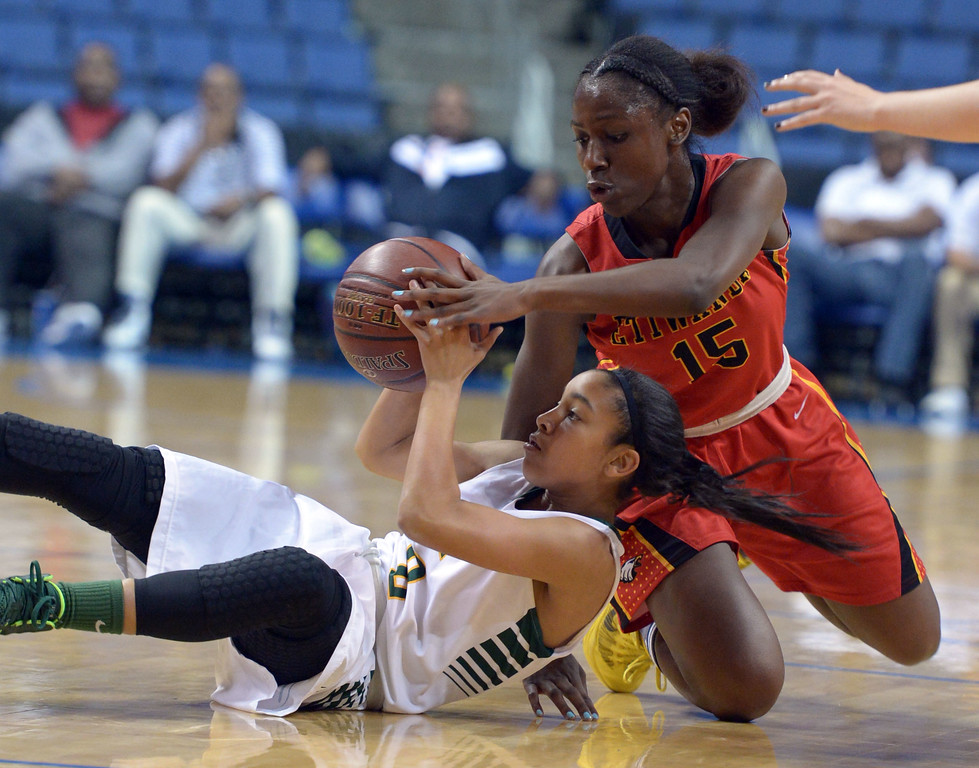 . Poly\'s Briana Johnson and Etiwanda\'s McKenzie Fort scramble after a loose ball at Citizens Business Bank Arena in Ontario, CA on Saturday, March 22, 2014. Long Beach Poly vs Etiwanda in the CIF girls open division regional final. 1st half, Photo by Scott Varley, Daily Breeze)