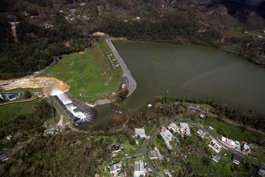 . Water drains from the Guajataca Dam in Quebradillas, Puerto Rico, Saturday, Sept. 23, 2017. Puerto Rican officials rushed to evacuate tens of thousands of people downstream of the failing dam and the massive scale of the disaster wrought by Hurricane Maria started to become clear. (AP Photo)