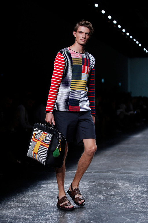 . A models wears a creation for Fendi men\'s Spring-Summer 2015 collection, part of the Milan Fashion Week, unveiled in Milan, Italy, Monday, June 23, 2014. (AP Photo/Luca Bruno)