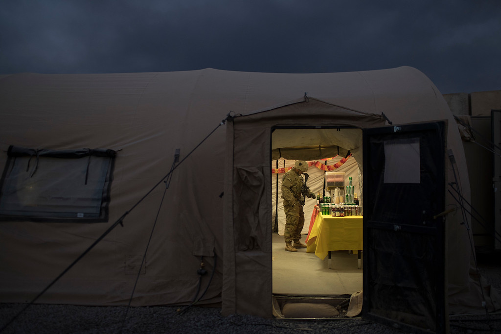 . A U.S. military service member grabs a drink during Thanksgiving dinner at a coalition air base in Qayara south of Mosul, Iraq, Thursday, Nov. 24, 2016. (AP Photo/Felipe Dana)