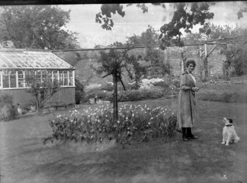 Eunice Bisco wife of Robert Bisco (Mama) on the lawn at The Red house. I remember s story my Dad told me of his brother John sitting up in a bedroom window facing the garden and one by one he shot off every head of the tulips seen in the center lawn display. His Mum Eunice was so mad at him!