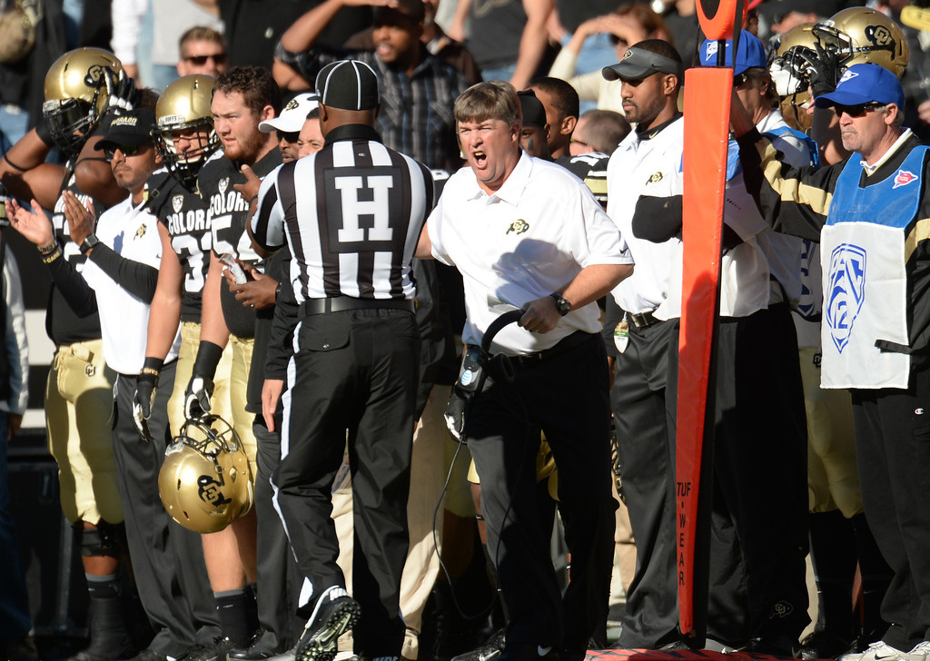. Head coach Mike Macintyre of University of Colorado shouts to Head Linesman Edwin Walker about a play in the 1st half of the game against University of Oregon at Folsom Field. Boulder, Colorado. October 5, 2013. Oregon won 57-16. (Photo by Hyoung Chang/The Denver Post)