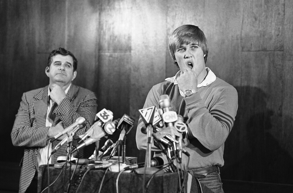 . FILE - This April 26, 1983, file photo shows Stanford university quarterback John Elway announcing that he�ll play baseball for the New York Yankees rather than sign with the Baltimore Colts, as his father Jack looks on, during a news conference in San Jose, Calif.  The rest as Denver Broncos fans will tell you, is history. (AP Photo/Paul Sakuma, File)