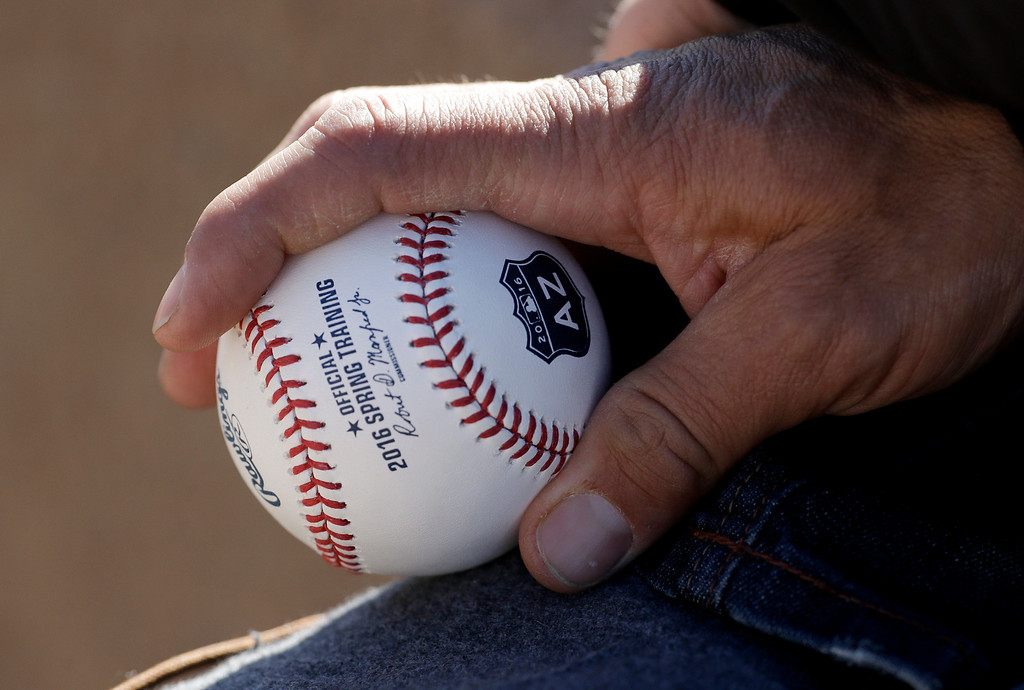 . A Colorado Rockies fan waits for an autograph during spring training baseball practice in Scottsdale, Ariz., Monday, Feb. 22, 2016. (AP Photo/Chris Carlson)