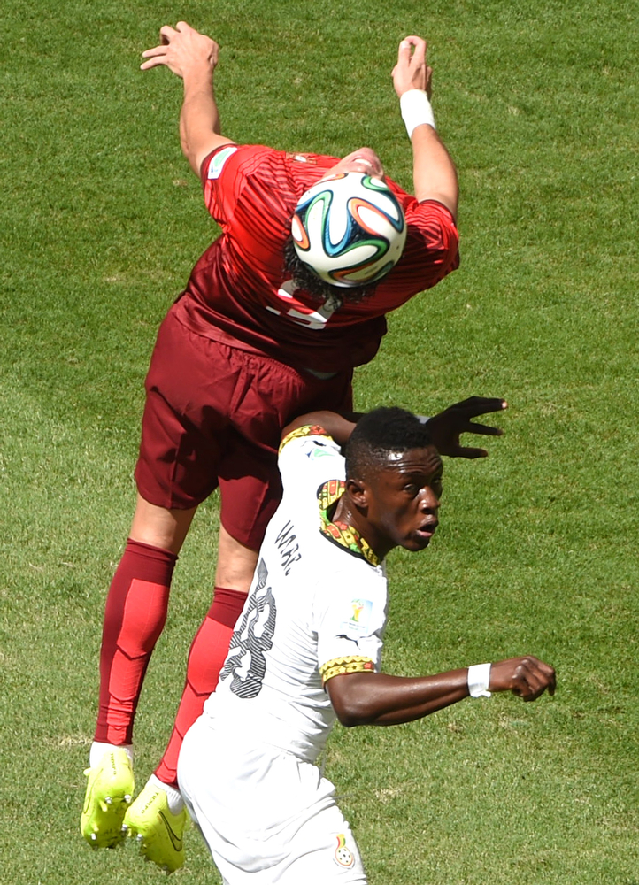 . Portugal\'s defender Pepe (top) and Ghana\'s forward Abdul Majeed Waris vie for the ball during the Group G football match between Portugal and Ghana at the Mane Garrincha National Stadium in Brasilia during the 2014 FIFA World Cup on June 26, 2014.  (EVARISTO SA/AFP/Getty Images)