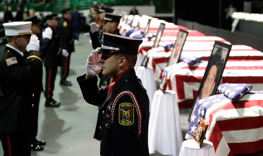 . Honor guard salute as they change shift prior to a memorial service for first responders who died in last week\'s fertilizer plant explosion in West, Texas, Thursday, April 25, 2013, in Waco, Texas.  (AP Photo/Eric Gay)