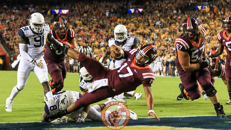 QB Josh Jackson falls into the endzone to score Virginia Tech's first touchdown of the game. (Mark Umansky/TheKeyPlay.com)