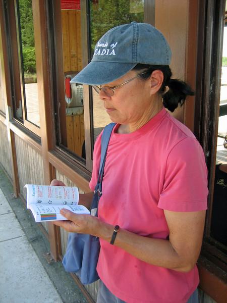 7_28 16 Venice Torcello Dorothy studying Italian.JPG