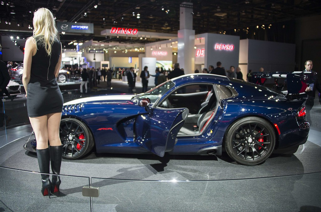 . A model stands in front of the Dodge Viper at the North American International Auto Show in Detroit, Michigan, January 12, 2016.    AFP PHOTO / JIM WATSON/AFP/Getty Images