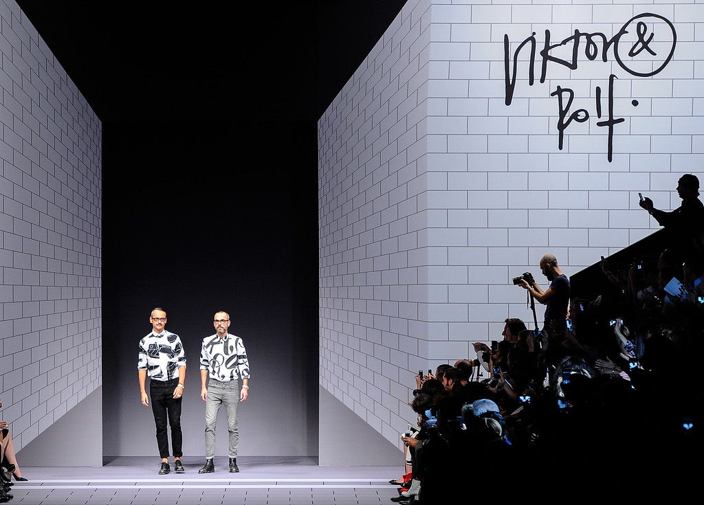 . Fashion designers Viktor Horsting and Rolf Snoeren acknowledge applause the end of the Viktor and Rolf ready-to-wear Spring/Summer 2014 fashion collection, presented Saturday, Sept. 28, 2013 in Paris. (AP Photo/Zacharie Scheurer)