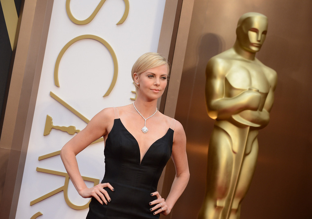 . Charlize Theron arrives at the Oscars on Sunday, March 2, 2014, at the Dolby Theatre in Los Angeles.  (Photo by Jordan Strauss/Invision/AP)