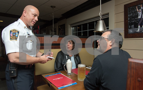 11/20/17 Wesley Bunnell | Staff The Bristol Police Department held a Tip a Cop event at 99 Restaurant on Monday evening to benefit the Special Olympics. Police Chief Brian Gould takes orders from Gale & Kevin Fuller who serves as a police commissioner.